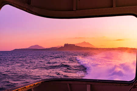 Ischia island in Italy view from the sea at sunset