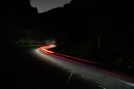 Long exposure of cars travelling through Cheddar gorge in Somerset at night Stock fotó