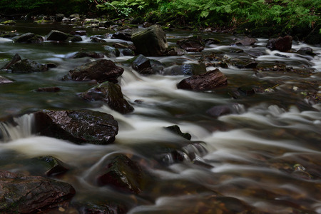 Long exposure of the river flowing at crook pool at Watersmeet in Devon Stock Photo