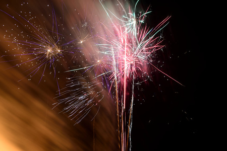 Long exposure of fireworks exploding in the sky at night