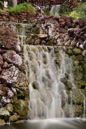 Long exposure of a waterfall in Parque Taoro in Puerto De La Cruz in Tenerife Imagens - 120847700