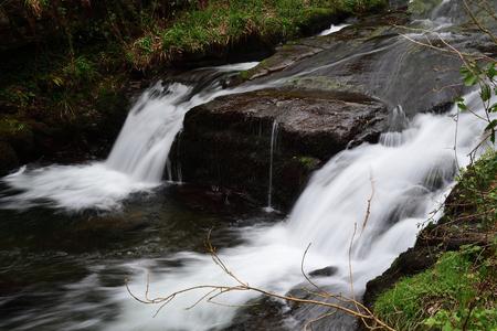Long exposure of a waterfall at Watersmeet in Devon Imagens