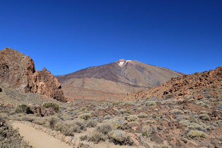 View of Mount Teide in Teide national park in Tenerife with a footpath in the foreground