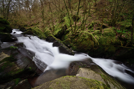 Long exposure of a waterfall in the woods at Watersmeet in Devon