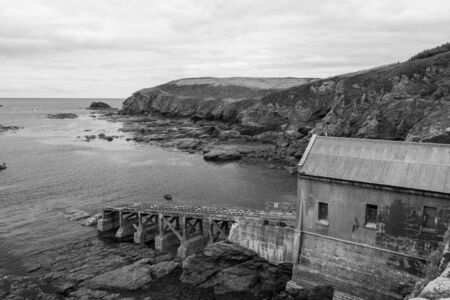 Black and white photo of the old lifeboat station at the Lizard in Cornwall
