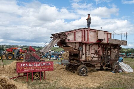 Haselbury Plucknett.Somerset.United Kingdom.August 18th 2019.A vintage threshing machine is on display at a yesterdays farming event