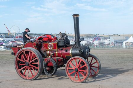 Blandford Forum.Dorset.United Kingdom.August 24th 2019.A vintage traction engine is being driven at The Great Dorset Steam Fair.