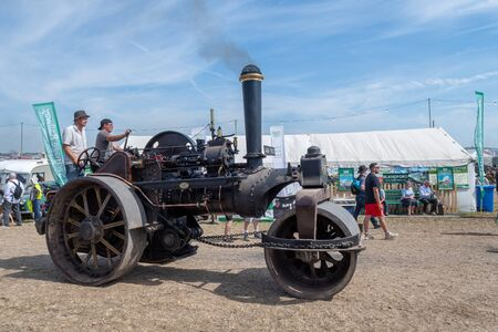 Blandford Forum.Dorset.United Kingdom.August 24th 2019.A vintage steam powered steam roller is being driven at The Great Dorset Steam Fair. 報道画像