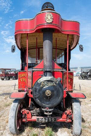 Blandford Forum.Dorset.United Kingdom.August 24th 2019.A red Foden steam powered bus is on display at the Great Dorset Steam fair.