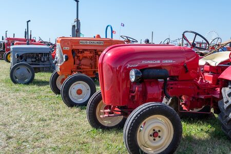 Blandford Forum.Dorset.United Kingdom.August 24th 2019.A row of restored vintage tractors is on display at the great Dorset steam fair. 報道画像