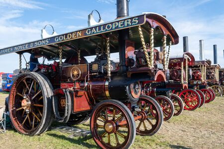 Blandford Forum.Dorset.United Kingdom.August 24th 2019.A row of restored antique traction engines is on display at the Great Dorset Steam Fair. 報道画像
