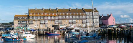 Panoramic photo of Pier Terrace in West bay in Dorset.