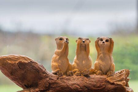 Three ceramic meerkats depicting the proverb.Speak no evil.See no evil.Hear no evil. Zdjęcie Seryjne