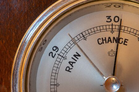 Close up of an antique barometer indicating high pressure