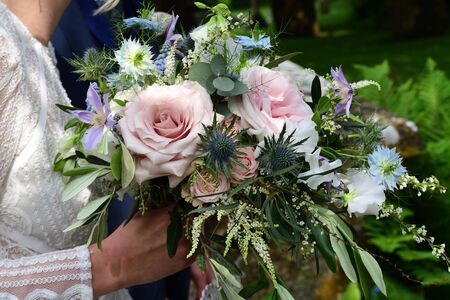 Close up of a brides boquet of flowers at a wedding