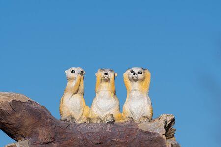 Close up of an ornament of three meerkats depicting the proverb hear no evil see no evil speak no evil. Banco de Imagens