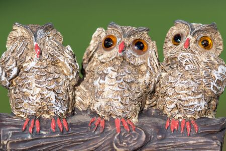 Close up of an ornament of three owls depicting the proverb see no evil hear no evil speak no evil.