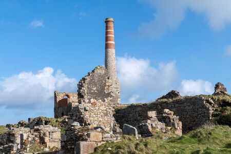 Landscape photo of an abandoned building from the mining industry on the Cornish caost
