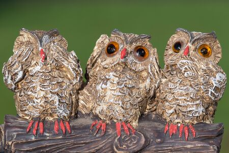Close up of an ornament of three owls depicting the proverb see no evil hear no evil speak no evil. Stock Photo