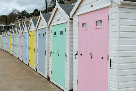 Line of beach huts at Lyme Regis in Dorset.