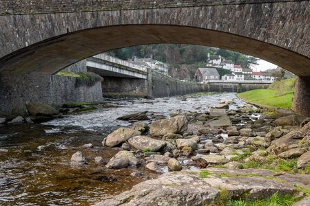 View of the East Lyn river flowing under the bridge into Lynmouth i in Devon