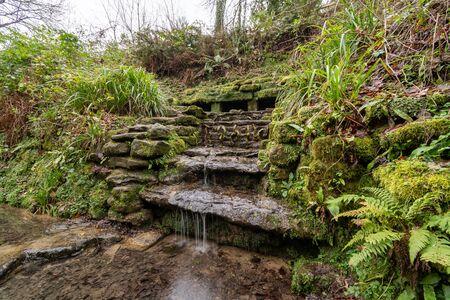 Long exposure of a waterfall in Ninesprings country park in Yeovil in Somerset