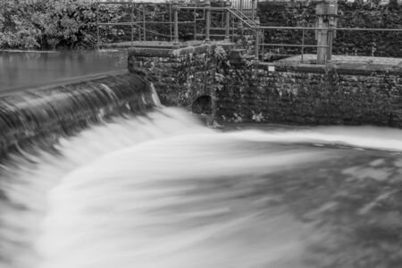 Black and white photo of a waterfall in Cheddar village in Somerset