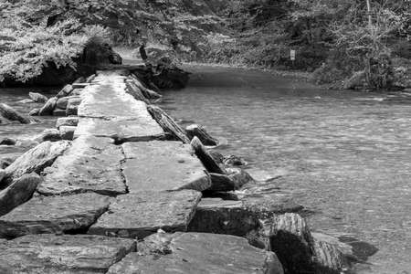 Black and white photo of the clapper bridge at Tarr Steps in Exmoor National Park Zdjęcie Seryjne