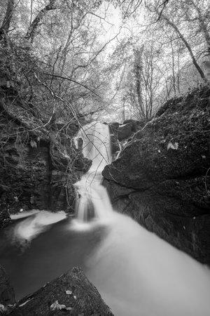 Long exposure of a waterfall on the Hoar Oak Water river at Watersmmet in Exmoor National Park