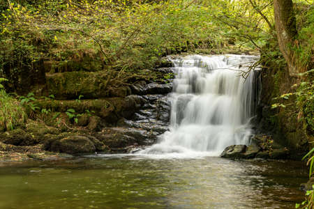 Long exposure of the big waterfall at Watersmeet in Exmoor National Park 写真素材