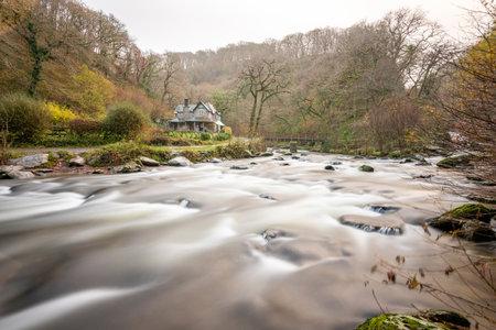 Long exposure of the East Lyn river flowing by Watersmeet house in Exmoor national park