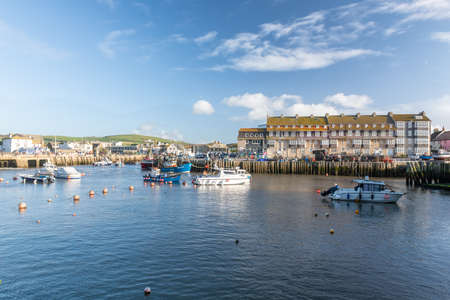 West Bay.Dorset.United Kingdom.December 12th 2020.View of the Pier Terrace at West Bay in Dorset