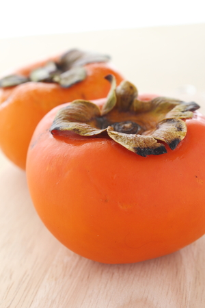 astringent: Persimmon fruit on wood backgrounds