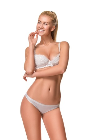 human leg: Young blonde woman wearing white underwear isolated over white background Stock Photo