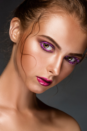naked girl black hair: Beauty woman face closeup isolated on black background. Beautiful model girl with violet makeup