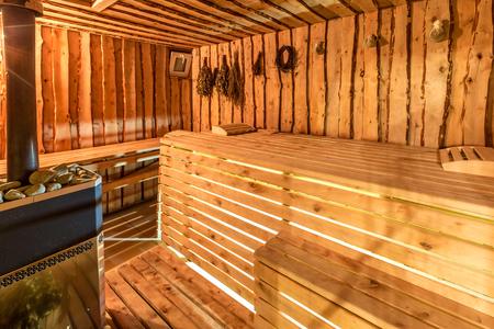 finland sauna: Large standard design classic wooden sauna interior.