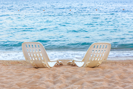 tropical island: Landscape of Two Lonely beachchairs on the sand near sea in the morning at a perfect beach in Egypt