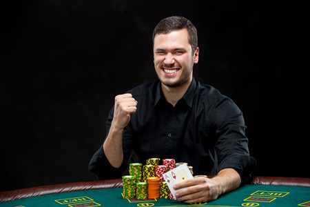poker player: Happy poker player winning and holding a pair of aces, concept of winning or having the upper hand Stock Photo