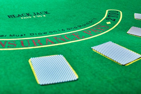 lear: casino, gambling, poker, and entertainment concept - playing cards on green table surface Stock Photo
