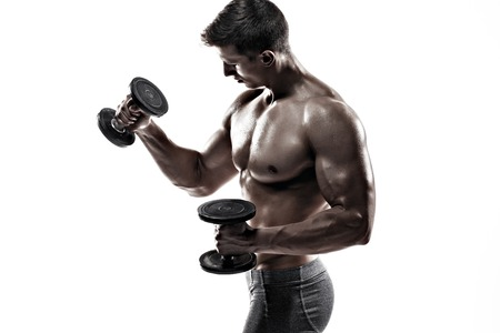 muscular body: Athletic man showing muscular body and doing exercises with dumbbells, isolated on white background.