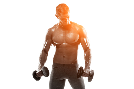 solar flare: Athletic man showing muscular body and doing exercises with dumbbells, isolated on white background. Whith solar flare Stock Photo