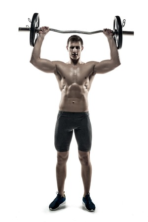 adult nude: Full length portrait of a muscular man athlete exercising with a barbell, isolated on white background