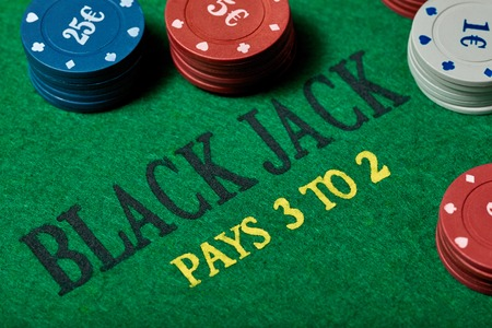 black jack: Black Jack gambling table with casino chips, close-up. Casino, gambling, poker, and entertainment concept