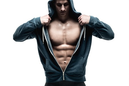 male chest: Handsome man with open jacket revealing muscular chest and abs, isolated on white background