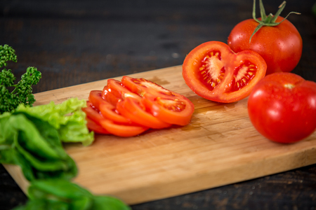 tomato slice: Close up cutting tomato, making salad. Chief cutting vegetables. Healthy lifestyle, diet food