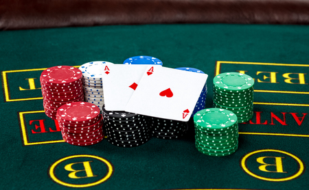 jack of clubs: Poker play. Chips and cards on the green table Stock Photo