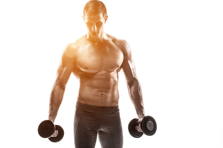 solar flare: Muscular man showing perfect body with dumbbells and looking at the camera, isolated on white background. Whith solar flare