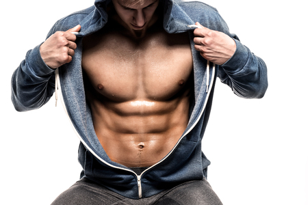 revealing: Handsome man with open jacket revealing muscular chest and abs, isolated on white background