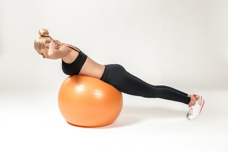 fitball: Young blonde woman training with fitball. Fitness exercises for abdomen