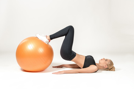fitball: Young blonde woman training with fitball. Fitness exercises Stock Photo
